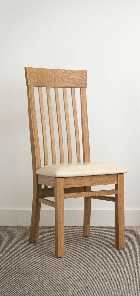 Set Of Two Solid Chunky Oak Dining Chair With Cream Bonded Leather Pads